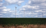 Midwestern Wind Turbines Keep Fresh Breeze Over Nearby Crops